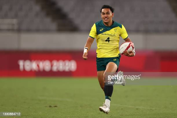 Dietrich Peter Roache of Team Australia in action during the Rugby Sevens Men's Quarter-final match between Australia and Fiji on day four of the...