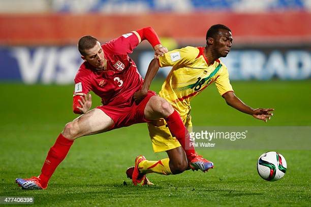 Dieudonne Gbakle of Mali is tackled by Nemanja Antonov of Serbia during the FIFA U20 World Cup Semi Final match between Serbia and Mali at North...