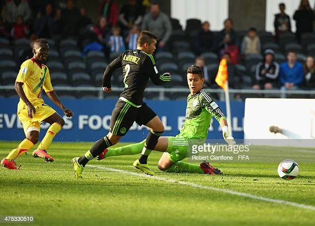 Dieudonne Gbakle of Mali shoots past Mexican goalkeeper Raul Gudino to score during the FIFA U-20 World Cup New Zealand 2015 Group D match between...