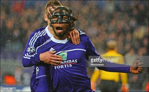 Dieudonne Mbokani of RSC Anderlecht celebrates after scoring the opening goal of the UEFA Champions League Group C match between RSC Anderlecht and...