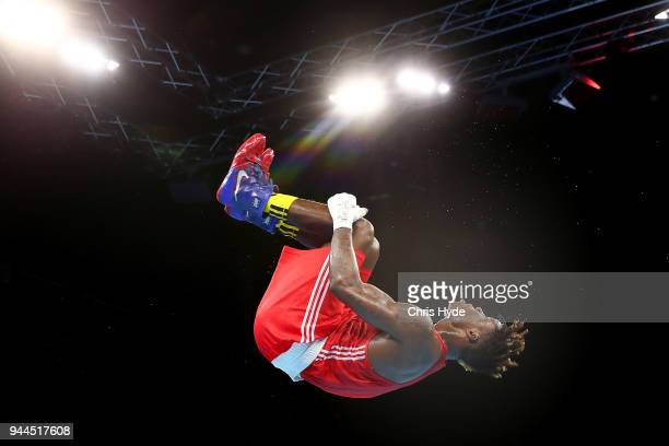 Dieudonne Wilfried Seyi Ntsengue of Cameroon celebrates winning against Ryan Scaife of New Zealand in the Men's 75kg quarterfinal Boxing on day seven...