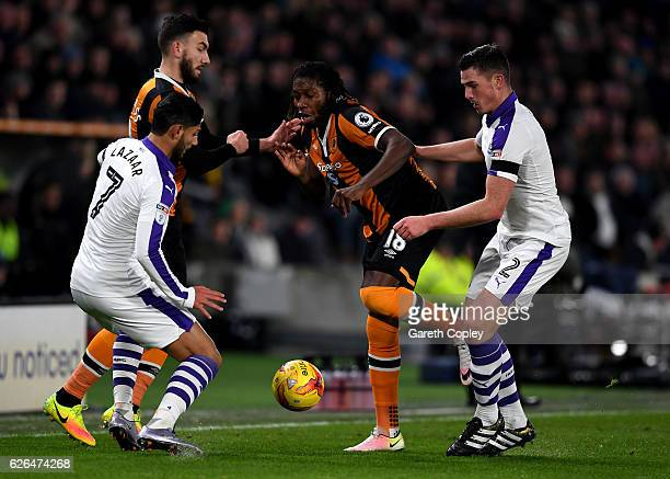 Dieumerci Mbokani and Robert Snodgrass of Hull City battle with Achraf Lazaar and Ciaran Clark of Newcastle United during the EFL Cup QuarterFinal...