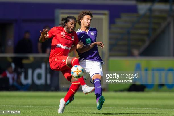 Dieumerci Mbokani of Antwerp and Philippe Sandler of Anderlecht fight for the ball during the Jupiler Pro League match between RSC Anderlecht and...
