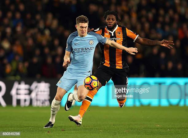 Dieumerci Mbokani of Hull City challenges John Stones of Manchester City during the Premier League match between Hull City and Manchester City at...
