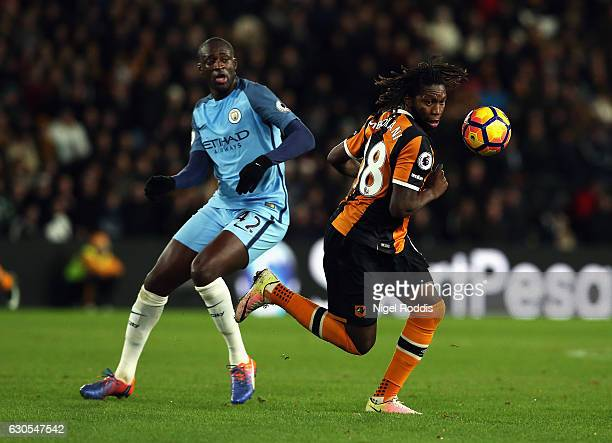 Dieumerci Mbokani of Hull City is challenged by Yaya Toure of Manchester City during the Premier League match between Hull City and Manchester City...
