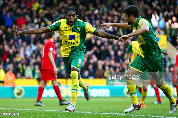 Dieumerci Mbokani of Norwich City celebrates scoring his team's first goal with his team mate Russel Martin during the Barclays Premier League match...