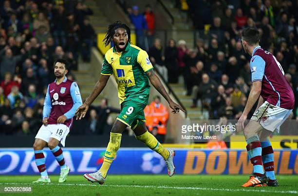 Dieumerci Mbokani of Norwich City celebrates scoring his team's second goal during the Barclays Premier League match between Norwich City and Aston...