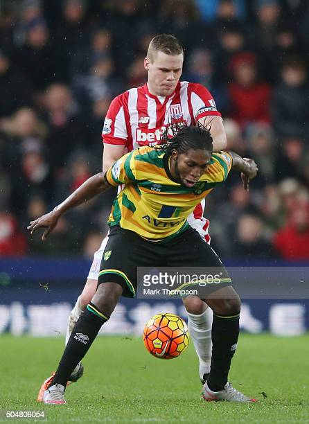 Dieumerci Mbokani of Norwich City controls the ball under pressure of the Ryan Shawcross of Stoke City during the Barclays Premier League match...