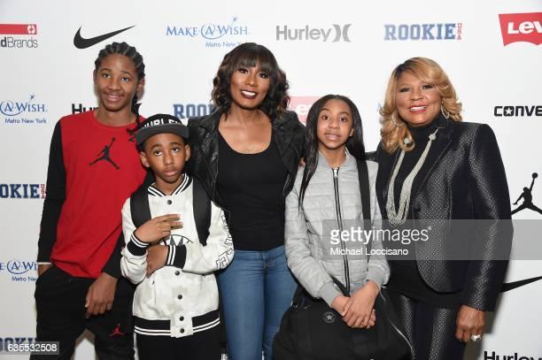 Diezel Braxton, Braxton Montelus Carter, Towanda Braxton, Brooke Carter and Evelyn Braxton pose backstage at the Rookie USA fashion show during New...