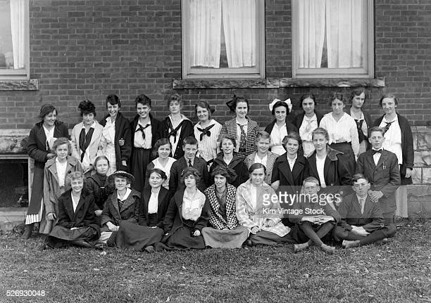 Different ages of students stand together for a school portrait in western New York State