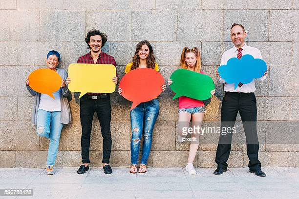 Different ages people holding speech bubbles