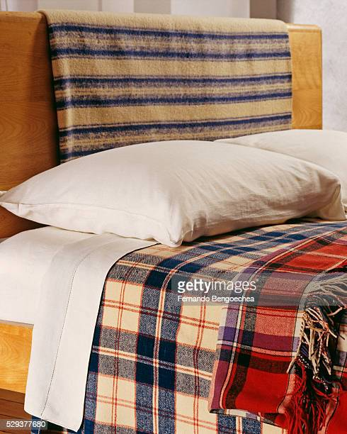 different blankets folded on a bed - fernando bengoechea stock pictures, royalty-free photos & images