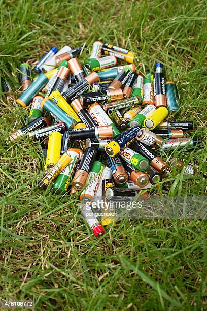 Different brand batteries on the grass