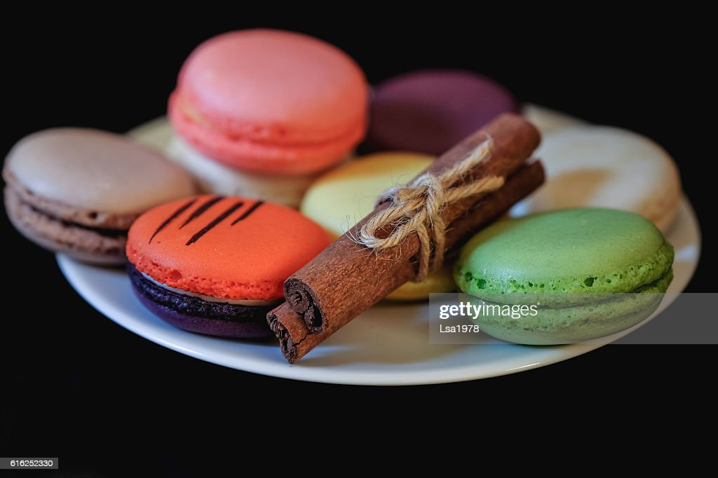 different colored macaroons on white plate : Stock Photo