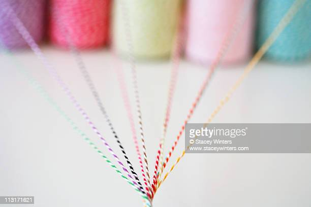 Different colored twine twisting together