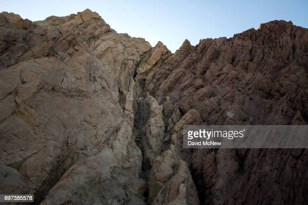 Different colors of earth are seen where tectonic plates collide on the San Andreas Fault in the Mecca Hills on June 17 2017 near Mecca California An...