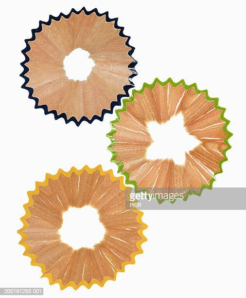 Different coloured pencil shavings forming cogs