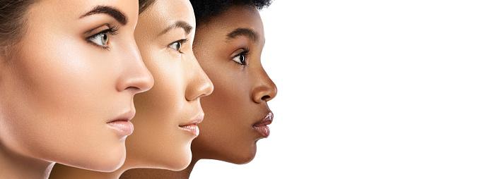 Different ethnicity women - Caucasian, African, Asian. 1013005478