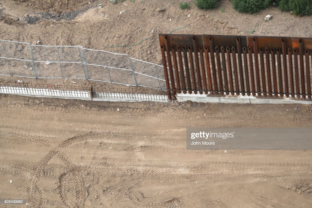 Different forms of fencing mark the U.S.-Mexico border on August 1, 2017 as seen from a U.S. Customs and Border Protection helicopter near Sunland Park, New Mexico. Logistical challenges, such as rugged terrain are just some of the complications facing the construction of a border wall proposed by President Trump.