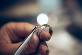 Different goldsmiths tools on the jewelry workplace. Jeweler at work in jewelry