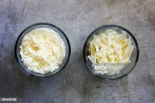 different grated parmesan in glass bowls - parmesan cheese stock pictures, royalty-free photos & images