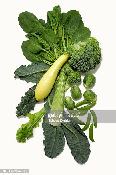 Different green vegetables on white background