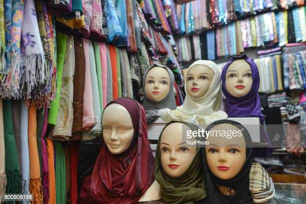 Different hijabs on display for sale inside Casablanca's Old Medina as people make their last purchases and buy presents ahead of Eid Al Fitr...