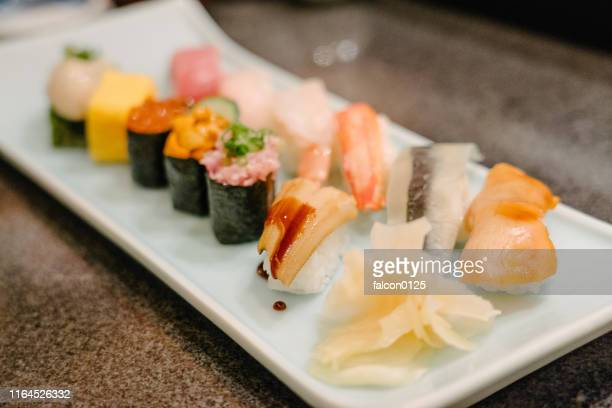 different kinds of delicious sushi in the plate - nigiri ストックフォトと画像