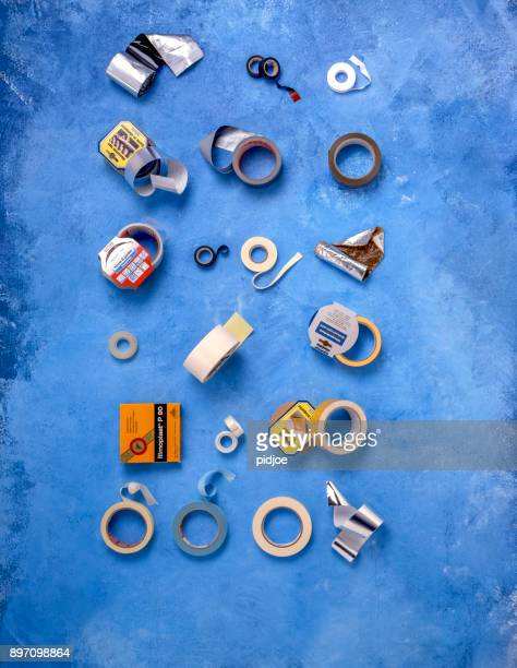 20 different kinds of insulating and sticky tapes on a blue background