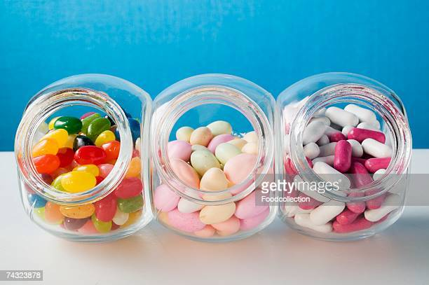 Different kinds of sweets in three sweet jars