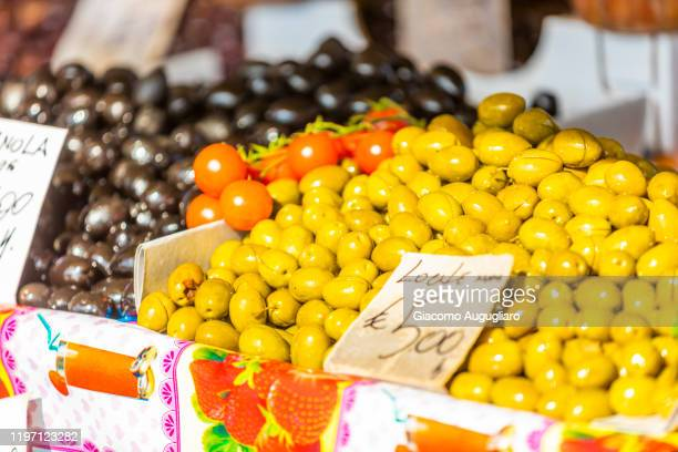 different local olives in the market of cefalù, palermo province, sicily, italy - giacomo palermo stock pictures, royalty-free photos & images