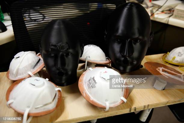Different masks that Albert Nazeeri uses for his experiment to disinfect respirator masks are inside his lab at the California Institute of...