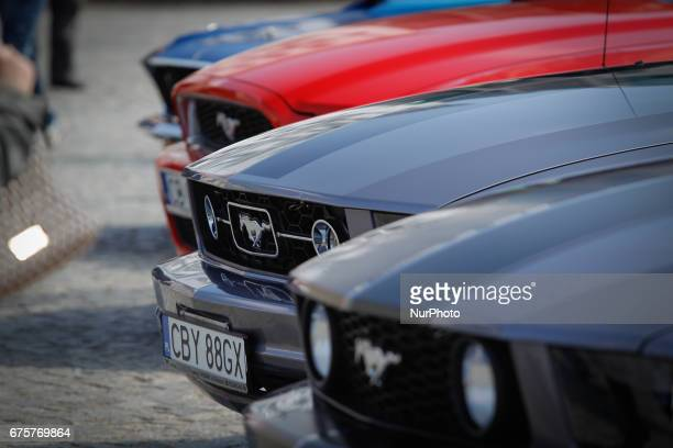 Different models of Ford Mustangs are seen during a classic car show on the Old Market Square in Bydgoszcz Poland on 1 May 2017