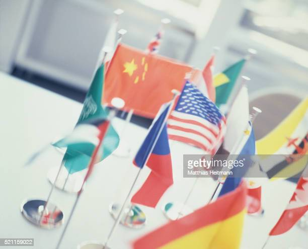 Different national flags on a table