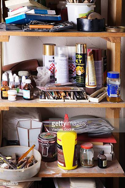 different objects on shelf in workshop