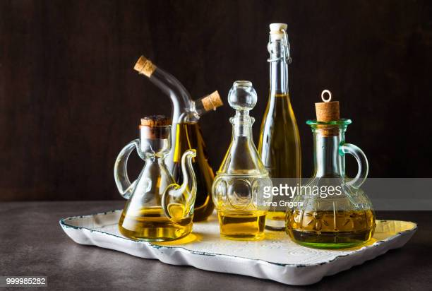 different shapes, types and sizes of cruets with olive oil on th