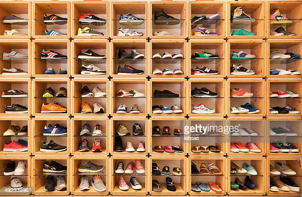different shoes displayed in a shoe shop. - collection stock pictures, royalty-free photos & images