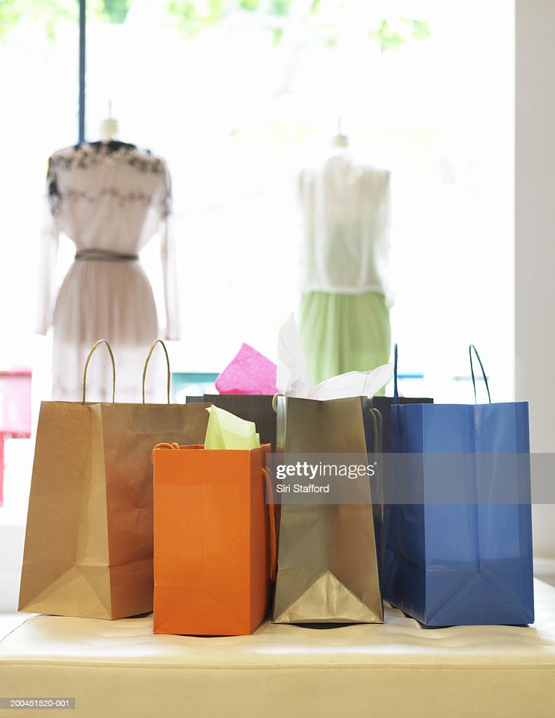 Different shopping bags in store : Stock Photo