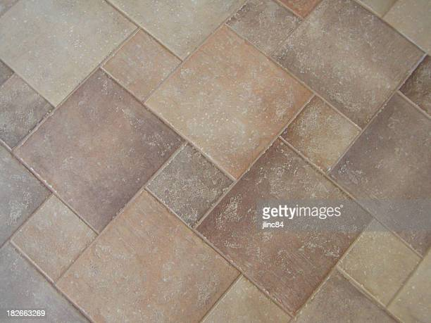 Different sized and asymmetrically arranged tiles on floor