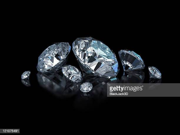 Different sized, cut and polished diamonds isolated on black