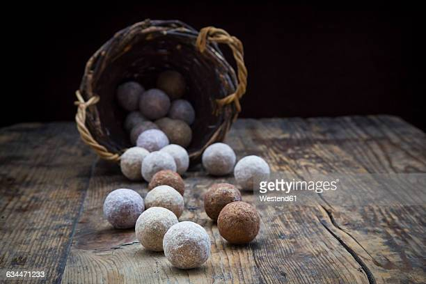 Different sorts of truffles on wood