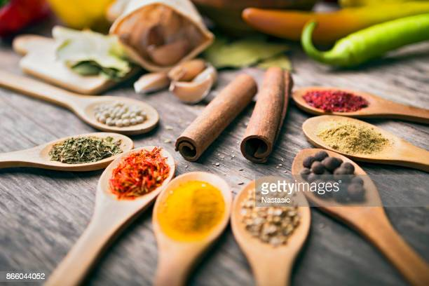 different spices arranged on wooden table ,still life - garlic clove imagens e fotografias de stock