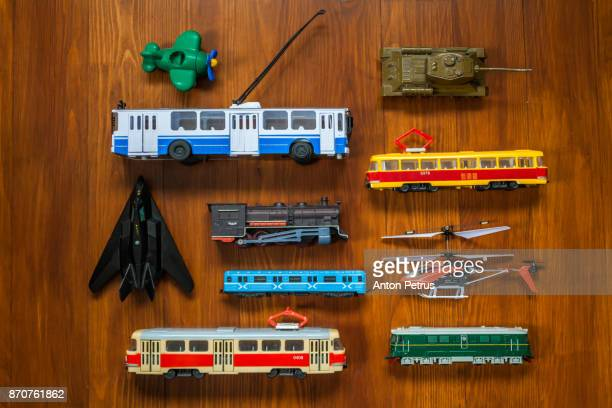 Different toy transport on a wooden background.Knolling style shot.