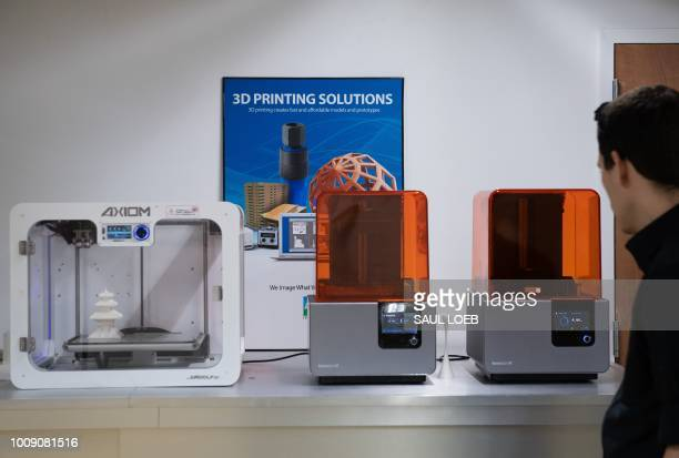 Different types of 3Dprinters are seen at ABC Imaging in Washington DC on August 1 2018 A US judge on July 31 2018 temporarily blocked the online...