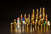 Different types of ammunition on a black background. Sale of weapons and ammunition. The right to hold a gun.