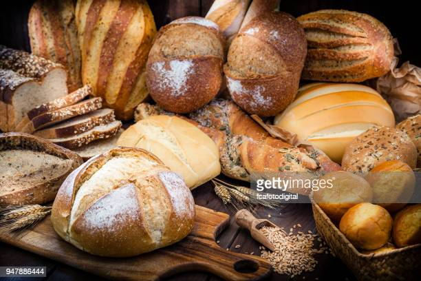 different types of bread still life - loaf of bread stock pictures, royalty-free photos & images