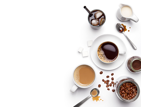 Different types of coffee and ingredients over white background with copy space 1048632574