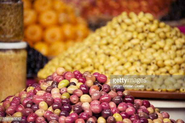 different types of fresh olives at an oriental market - luques olive stock pictures, royalty-free photos & images