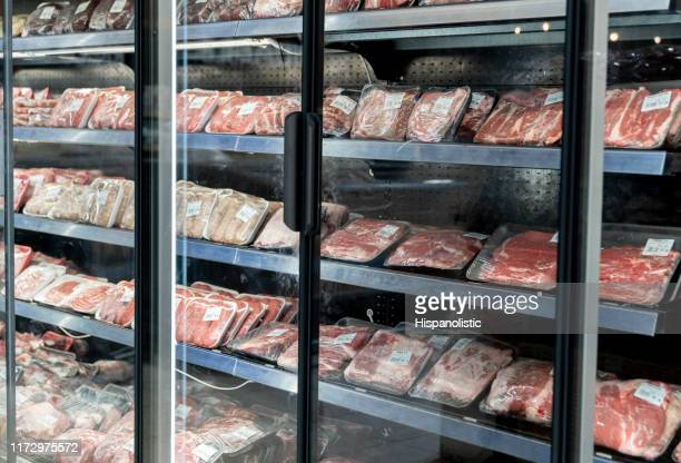 different types of packed meat at the refrigerated section of a supermarket - pork stock pictures, royalty-free photos & images