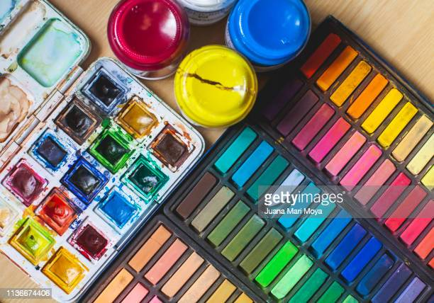 different types of paintings.  watercolors, temperas and chalk.  very colorful background - tempera painting stock pictures, royalty-free photos & images